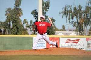 Jarret Martin As He Throws a Pitch for Hit King. Photo by Steve Sitter.